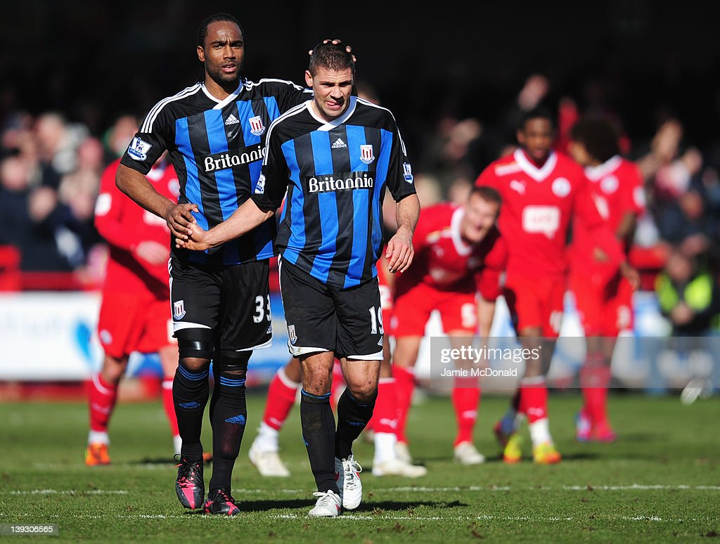 Crawley Twon players look dejected as goalscorer <a gi-track='captionPersonalityLinkClicked' href=/galleries/search?phrase=Jonathan+Walters&family=editorial&specificpeople=3389578 ng-click='$event.stopPropagation()'>Jonathan Walters</a> of Stoke City (19) is congratulated by team mate <a gi-track='captionPersonalityLinkClicked' href=/galleries/search?phrase=Cameron+Jerome&family=editorial&specificpeople=815275 ng-click='$event.stopPropagation()'>Cameron Jerome</a> during the FA Cup with Budweiser Fifth Round match between Crawley Town and Stoke City at Broadfield Stadium on February 19, 2012 in Crawley, West Sussex.