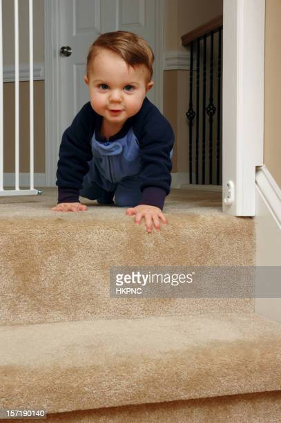 Crawling baby approaching stairs