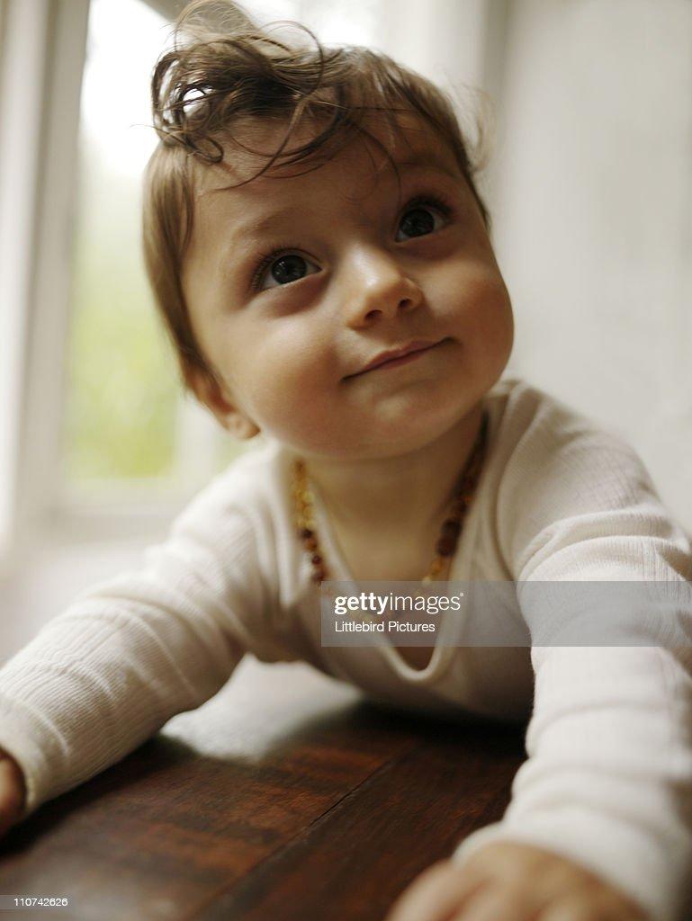 crawling baby smiling : Stock Photo