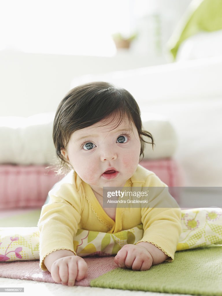 Crawling Baby with Big Eyes : Stock Photo