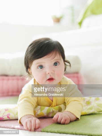 Crawling Baby with Big Eyes : Stock Photo