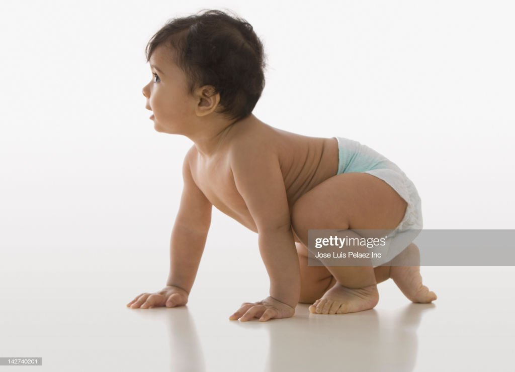 Crawling mixed race baby boy : Stock Photo