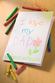 Crayons next to Father's Day card