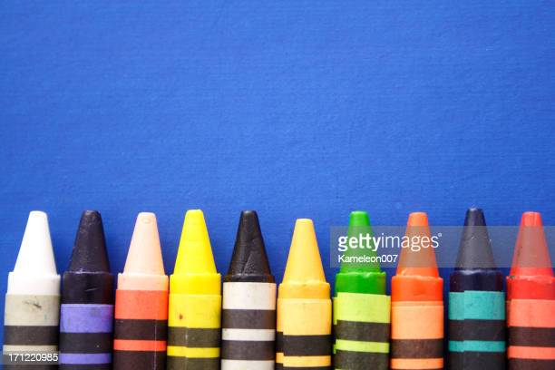 Crayons on blue