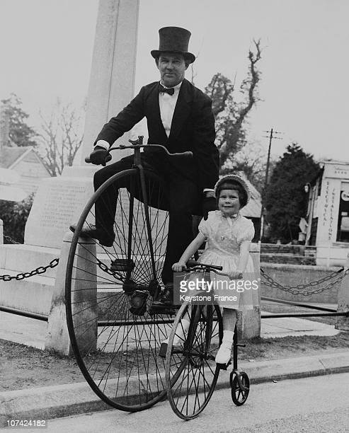 Craze For Penny Farthing Dad And Daughter On A Ride In England