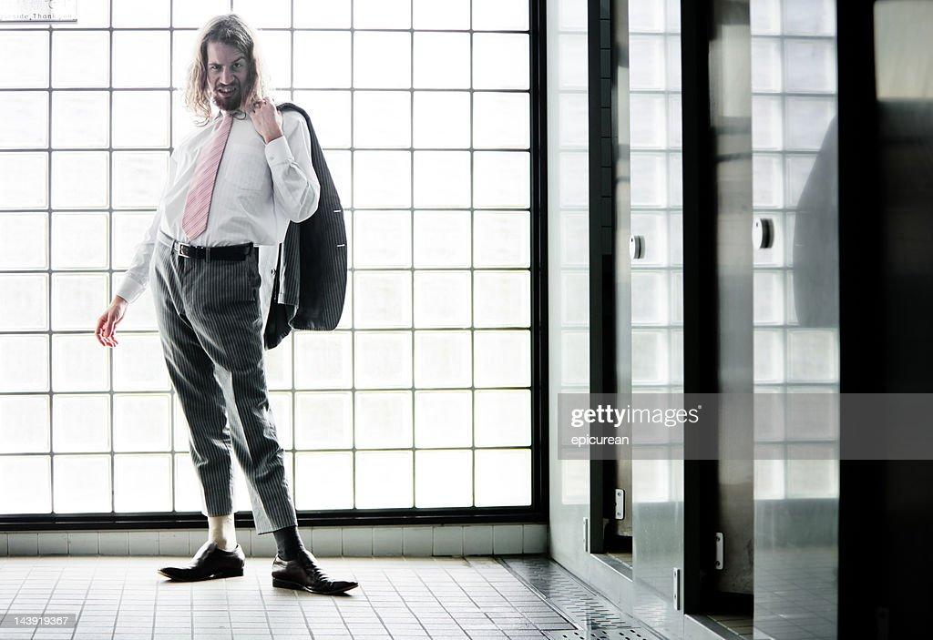 crazy businessman in the bathroom
