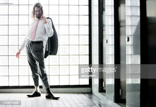 crazy businessman in the bathroom : Stock Photo
