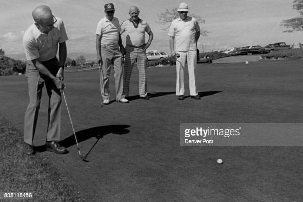 OCT 12 1983 'Crazy Golf' Tournament Benefits Arapahoe County Retarded Citizens Ned Koch Putts as form left Jack Wilson Stan Wiruth and Tom Harding...