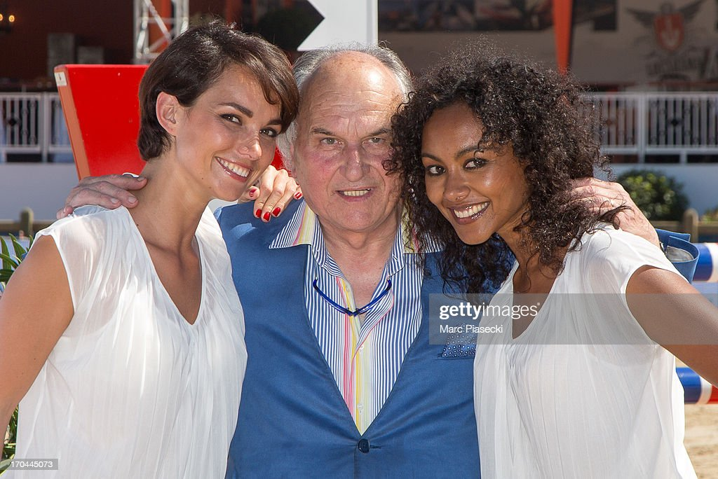 'Crazy Horse Saloon' dancers Enny Gmatic and Yaffa Yemella pose with Claude Bonucci (C) during the 'Longines Global Champions Tour of Cannes 2013' on June 13, 2013 in Cannes, France.