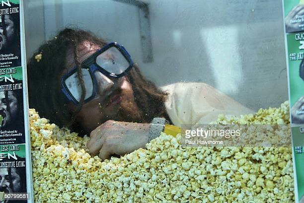 Crazy Legs Conti eats his way out of a box filled with popcorn to mark the premiere of the film 'Crazy Legs Conti Zen And The Art Of Competitive...