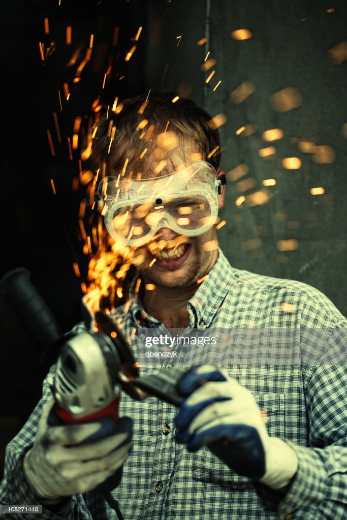 Crazy man with metal cutter. : Stock Photo
