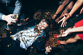 Crazy party. Drunk man lying on floor. New year, Birthday, Holiday Event concept