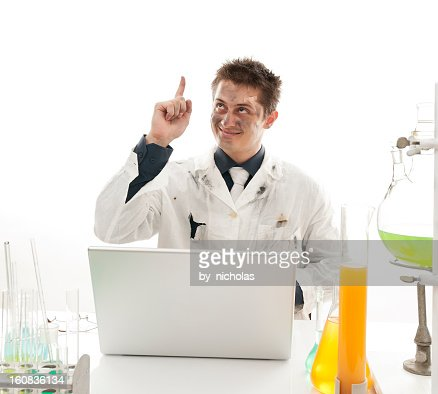 Crazy scientist in the lab, pointing up