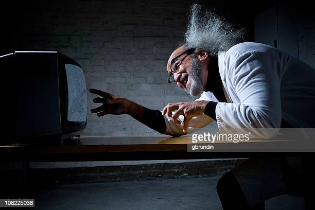Crazy Scientist with Wild Hair Looking at Television