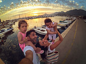 Crazy selfie family on pier