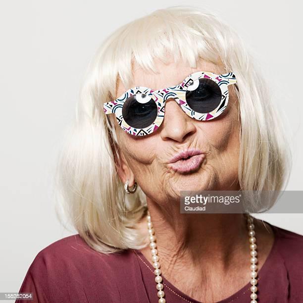 Crazy senior woman kissing