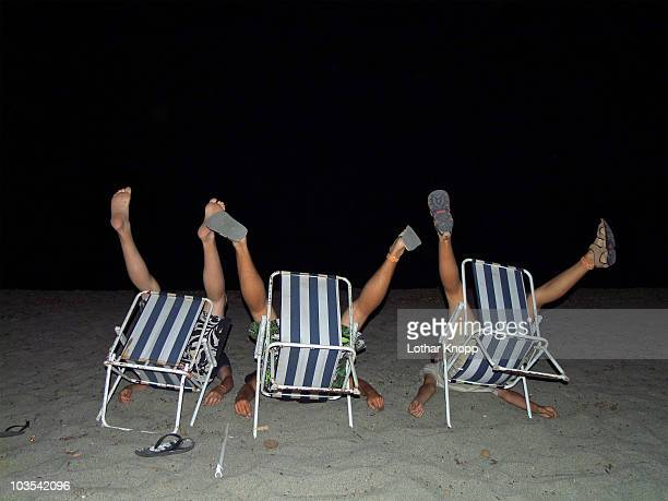 Crazy teenage beach boys fooling around