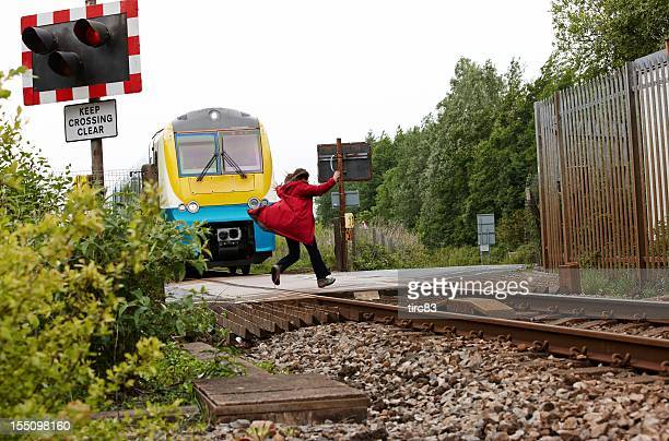 Crazy woman running out in front of moving train