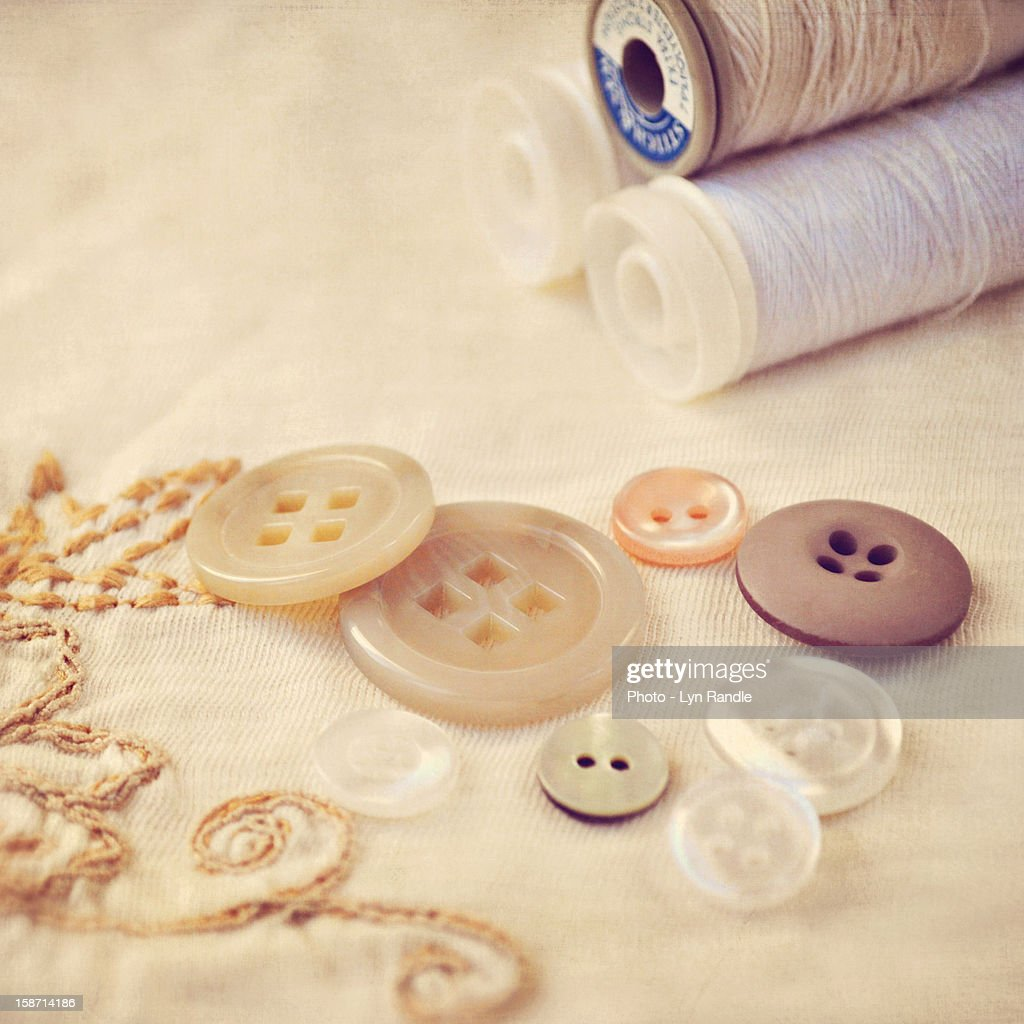 Cream and white cottons and buttons : Stock Photo