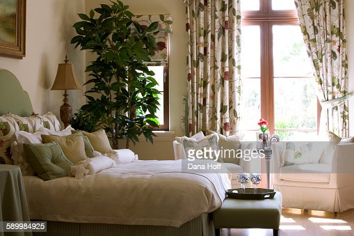 Bedroom Curtains cream bedroom curtains : Cream Bedroom With Potted Plant And Floral Curtains Stock Photo ...