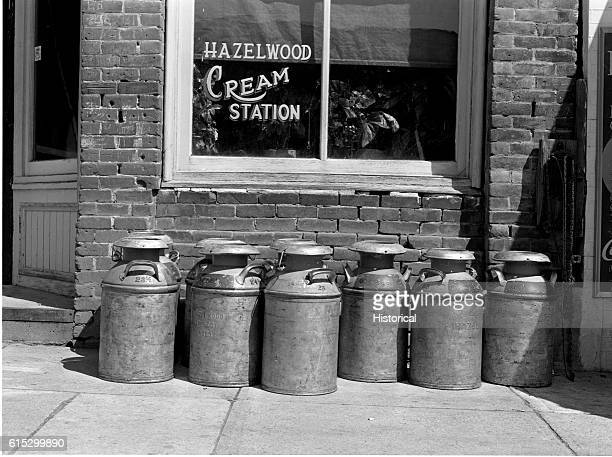 Cream cans lined in from of the Hazelwood Cream Station in Genesee Idaho July 1941