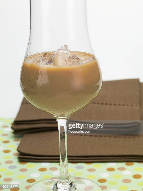 Cream liqueur with ice cubes in glass