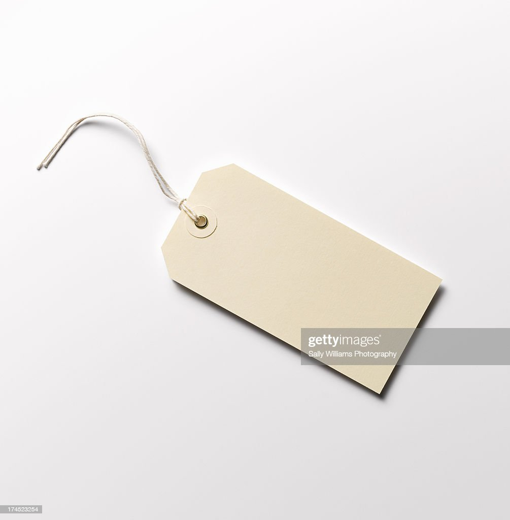 A cream paper luggage tag