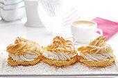 Cream puffs on tray, close-up