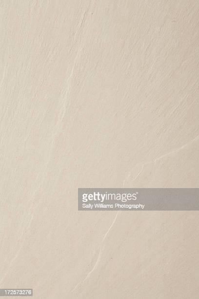 A cream riven stone background