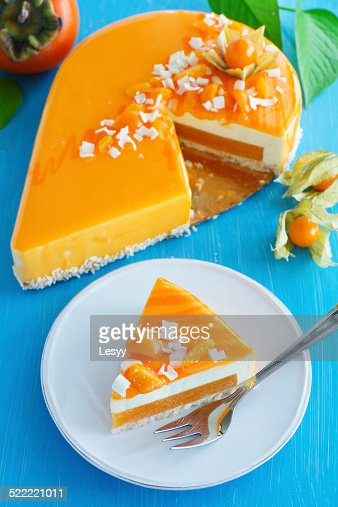 Creamy cake with coconut, mango and persimmon : Stock Photo