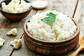 creamy cauliflower garlic rice on a dark wood background. the toning. selective focus