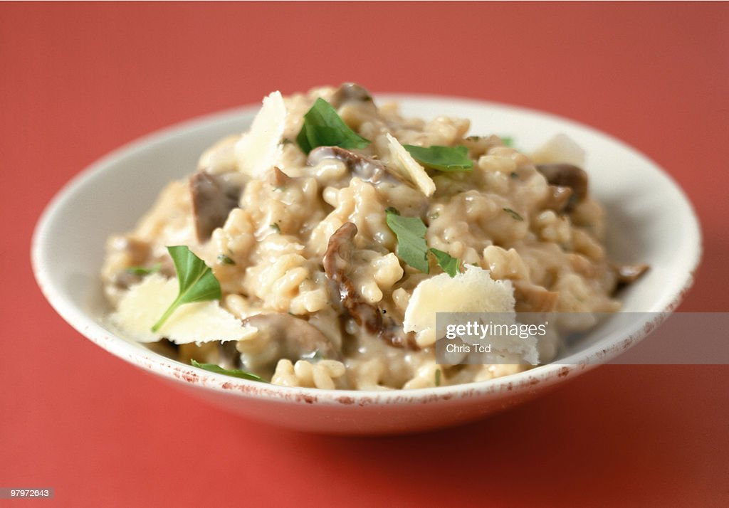 Creamy Mushroom Rissotto in Bowl & Parmeson Flakes