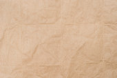 creased trcycled brown paper texture backgroundcreased trcycled brown paper texture background