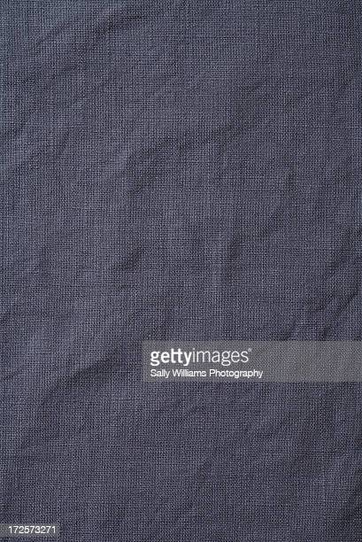 A creased grey cotton tablecloth
