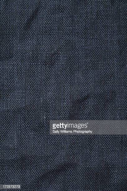 A creased petrol blue hessian tablecloth