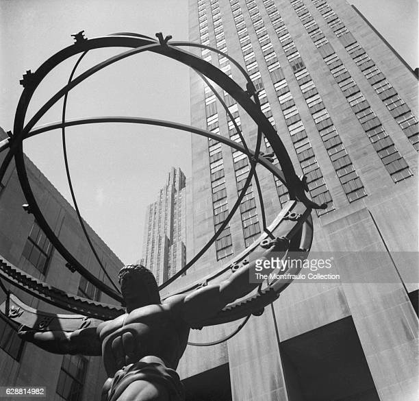 Created by sculptor Lee Lawrie with the help or Rene Paul Chambellan the bronxe statue of the Greek Titan Atlas holding the Heaves looms up in front...