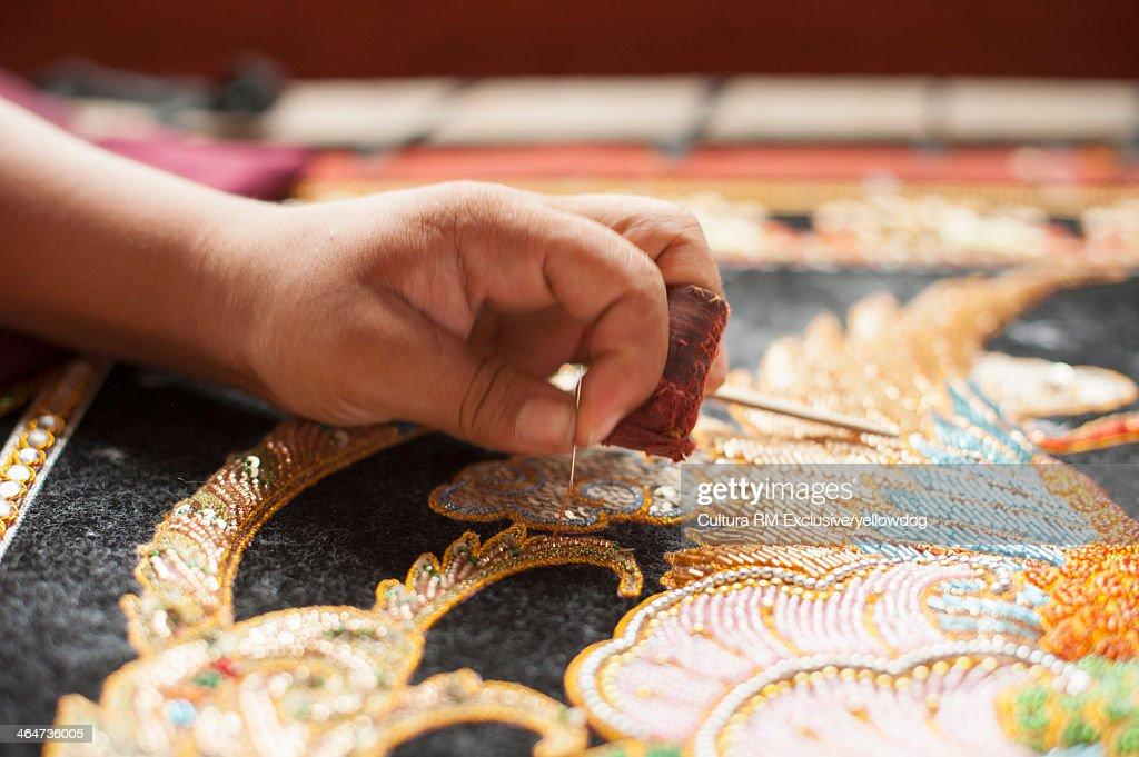 Creating a tapestry, Mandalay, Myanmar