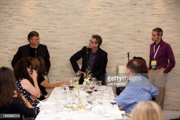 Creation director Jon Amiel Piers Handling director and CEO of TIFF and TIFF codirector learning Allen Braude attend the 52/7 Lunch at Sassafraz...