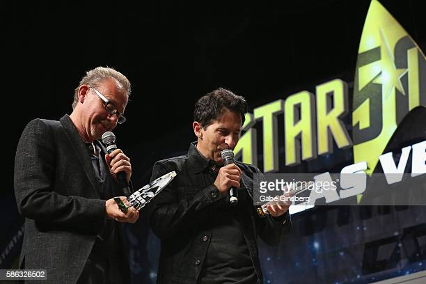 Creation Entertainment coowner Gary Berman and Creation Entertainment CEO and coowner Adam Malin recieve awards during 'The CoOwners of Creation...