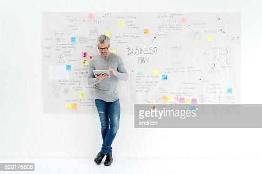 Creative business man making a business plan