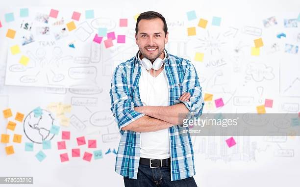 Creative business man with a wall chart