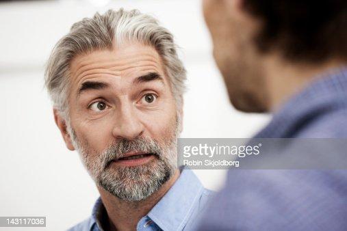 Creative business men having a talk : Stock Photo