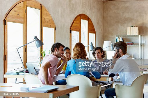 Creative business people discussing in office : Stock Photo