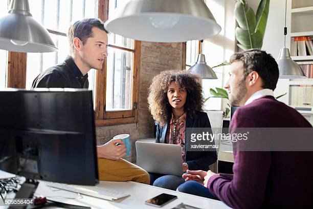 Creative business people having a casual discussion in the office