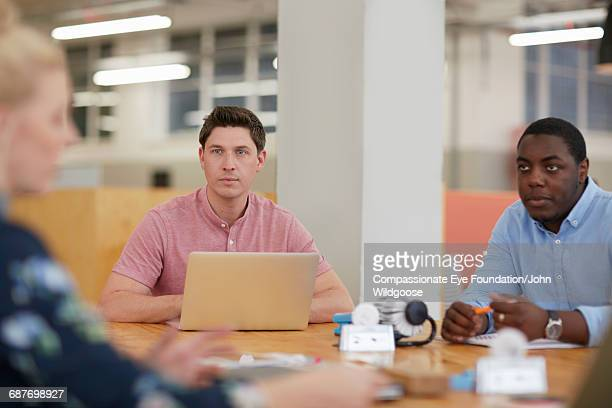 Creative business people listening in meeting