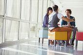 Creative business people meeting on vibrant stools