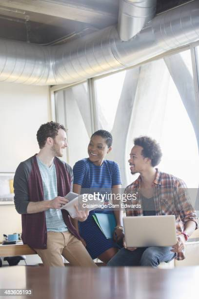 Creative business people talking in meeting