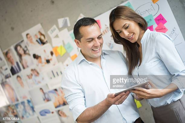 Creative business people using a tablet