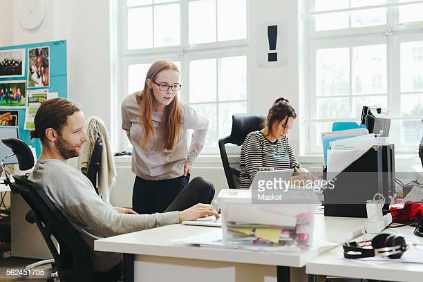 Creative business people working at desk in office