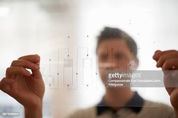 Creative businessman holding diagram